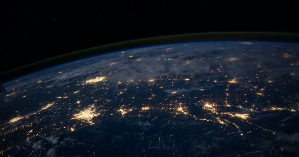 a network of lights spreading across the globe, the photo taken from space