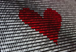 a screen filled with binary. red digits in the centre create the shape of a heart