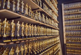 shelves lined with gold oscar-style statuettes