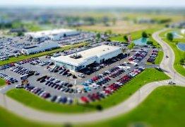 an aerial shot of a car dealership