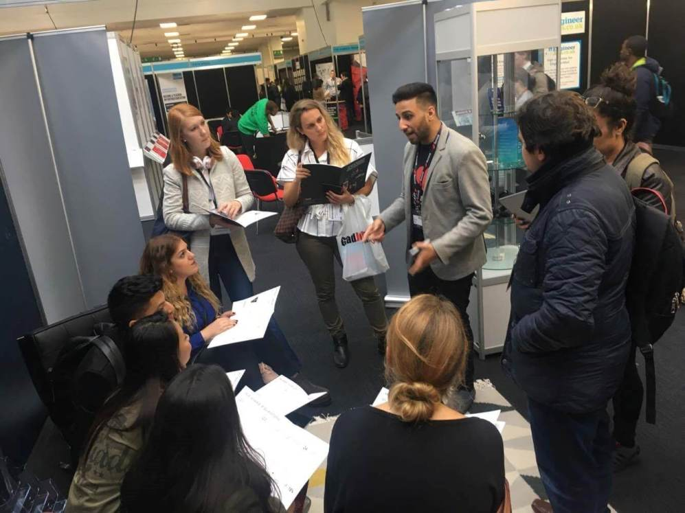 Abdul talking to prospective new Summiteers at the National Graduate Recruitment Expo
