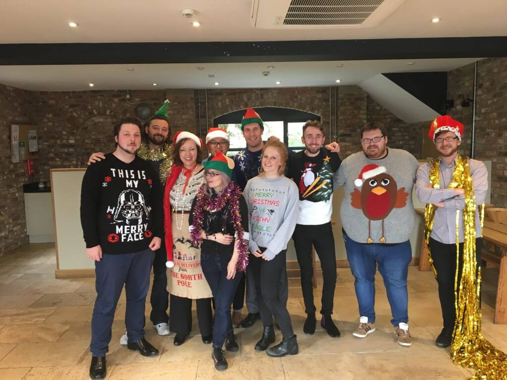 Summit retail experts looking festive in Christmas jumpers
