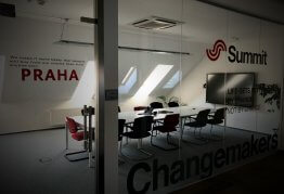 a newly decorated, openspaced office, with the Summit logo on the wall