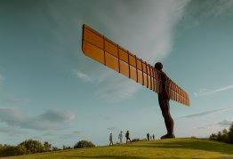 a landscape shot of the giant metal statue the angel of the north