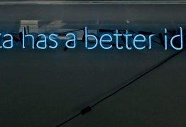 """a blue neon light sign reads """"data has a better idea."""""""