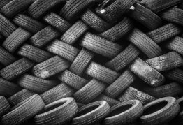 a basket-weave pattern made of interlaced car tyres