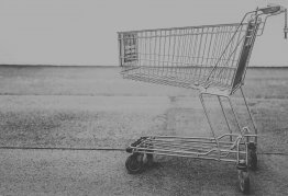 a black and white photo of a shopping trolley