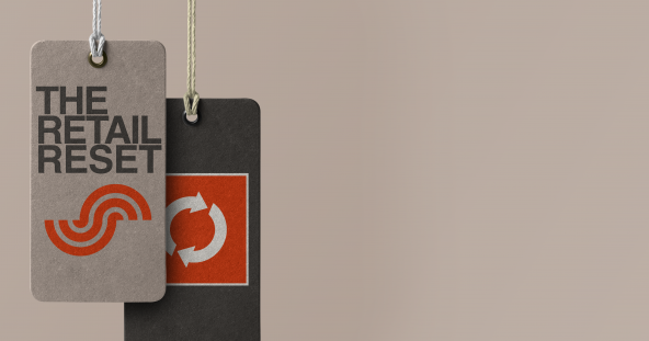 """two clothes tags hang against a grey background, they read """"the retail reset"""""""