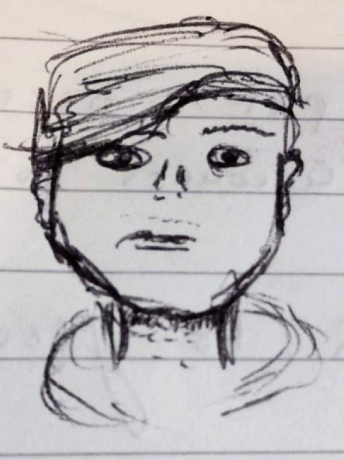 a hand drawn self portrait of a young man in biro on lined paper