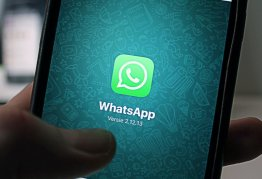 a smartphone is open to messaging app whatsapp