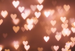 heart shaped bokeh on a pink background