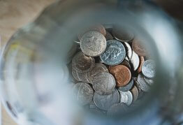 loose silver change in a money jar, viewed from above