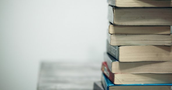 a stack of assorted books against a white background
