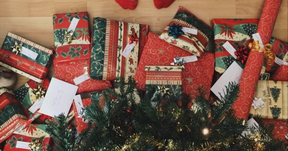 a birds eye view of christmas presents under a tree